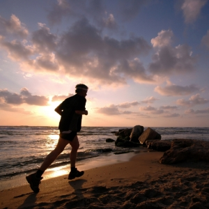 runner on beach - ©iStock.com - AlonO
